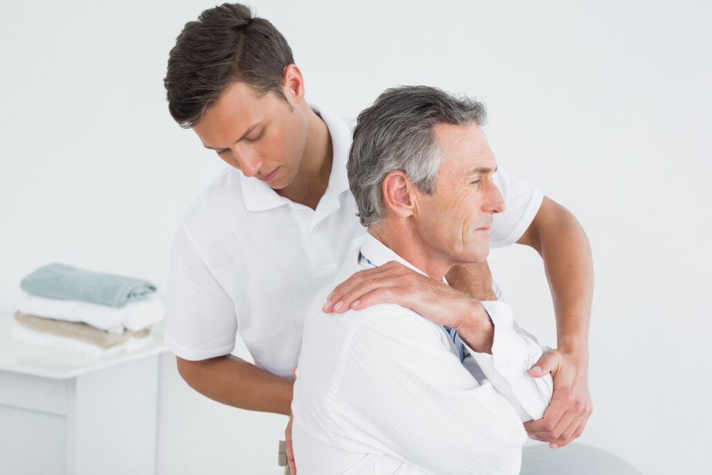 chiropractor examining the back